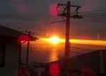 海からのぼる朝日(礼拝堂の窓から)